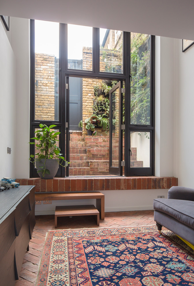 Example of a small urban open concept brick floor living room design in London