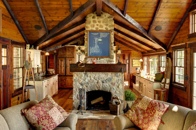 Mountain style living room photo in Minneapolis with a stone fireplace