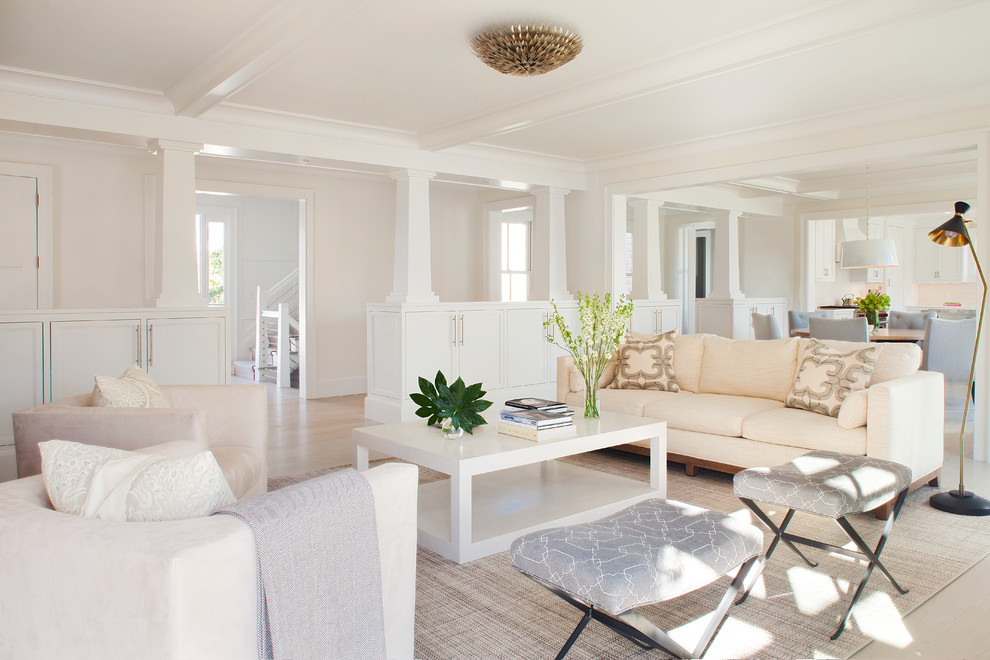 Inspiration for a transitional formal and open concept light wood floor living room remodel in Providence with white walls, a standard fireplace, a wood fireplace surround and no tv