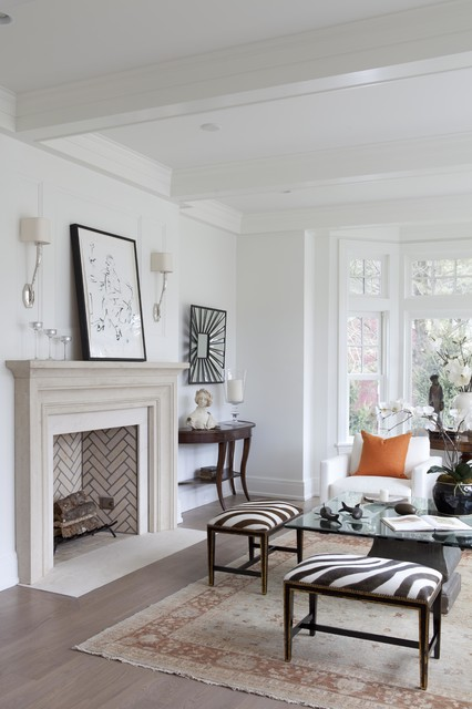 Example of a transitional living room design in New York