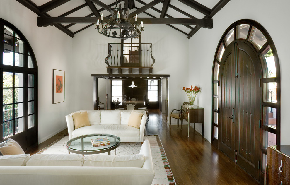 Living room - mediterranean formal and enclosed dark wood floor living room idea in New York with white walls