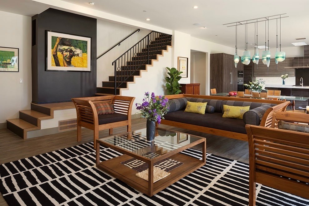 Living room - contemporary formal and open concept dark wood floor living room idea in Los Angeles with white walls