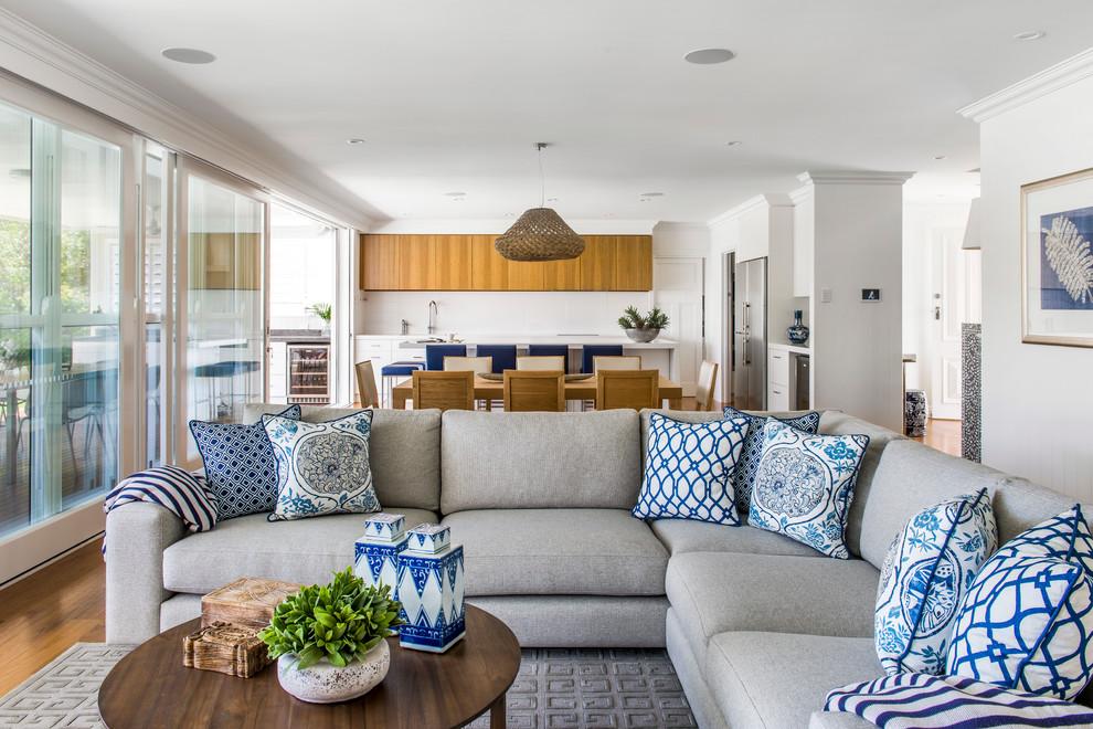 Trendy open concept living room photo in Brisbane