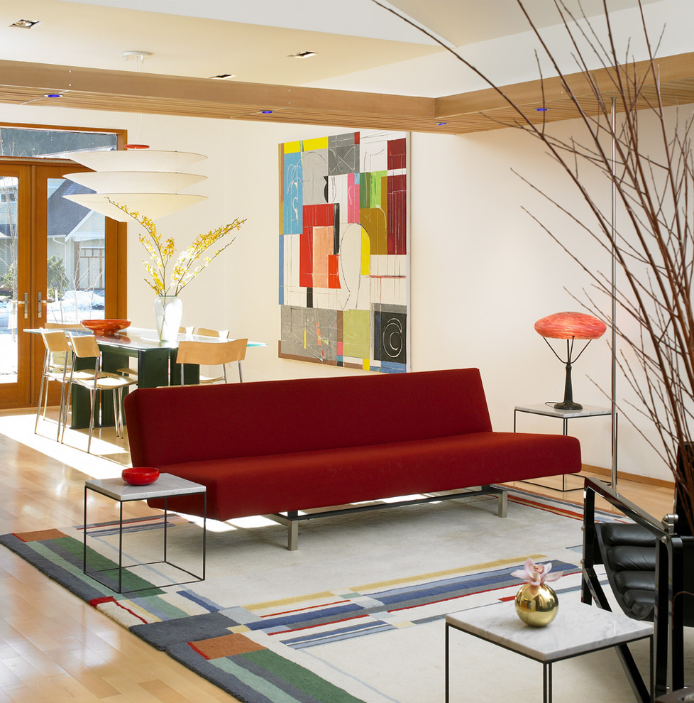 Inspiration for a modern open concept living room remodel in Vancouver with beige walls