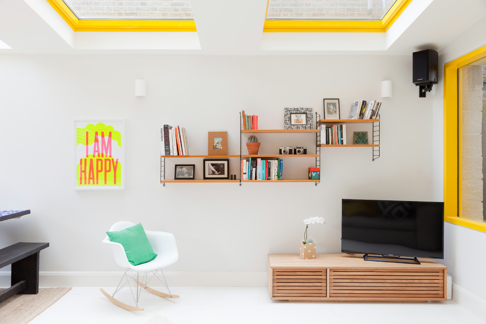 Trendy painted wood floor living room photo in London with white walls and a tv stand