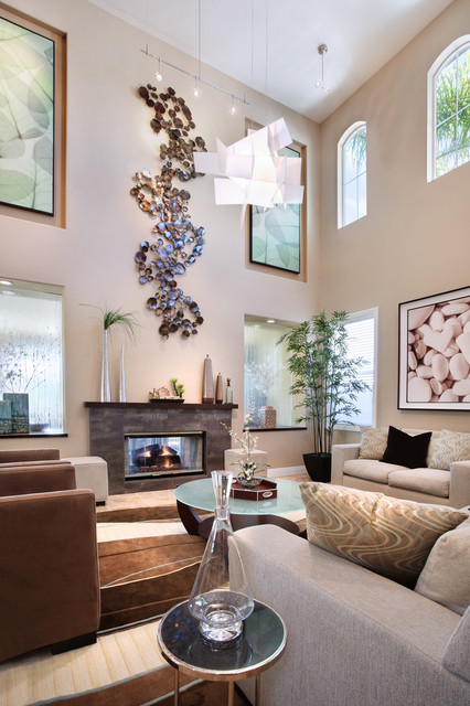 Living room - contemporary living room idea in Orange County with beige walls, a standard fireplace and no tv
