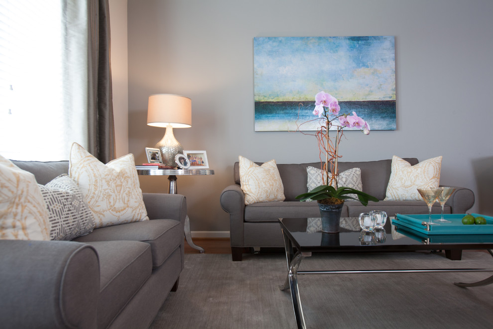 Example of a small minimalist open concept medium tone wood floor living room design in Houston with gray walls