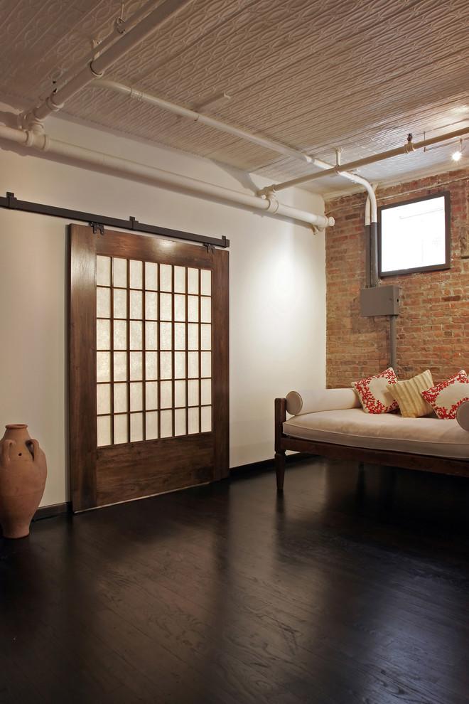 Living room - industrial dark wood floor living room idea in New York with white walls