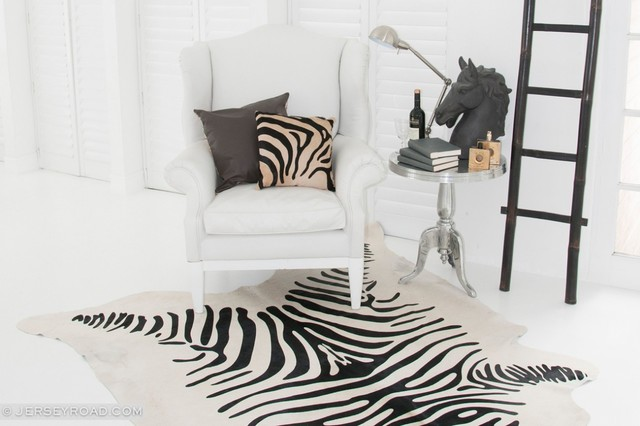 Zebra printed cowhide rug traditional living room for Living room ideas with zebra rug