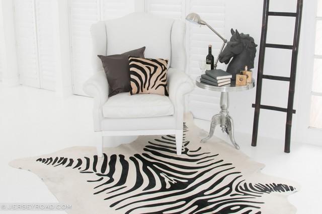 Zebra printed cowhide rug traditional living room for Living room ideas with zebra rug