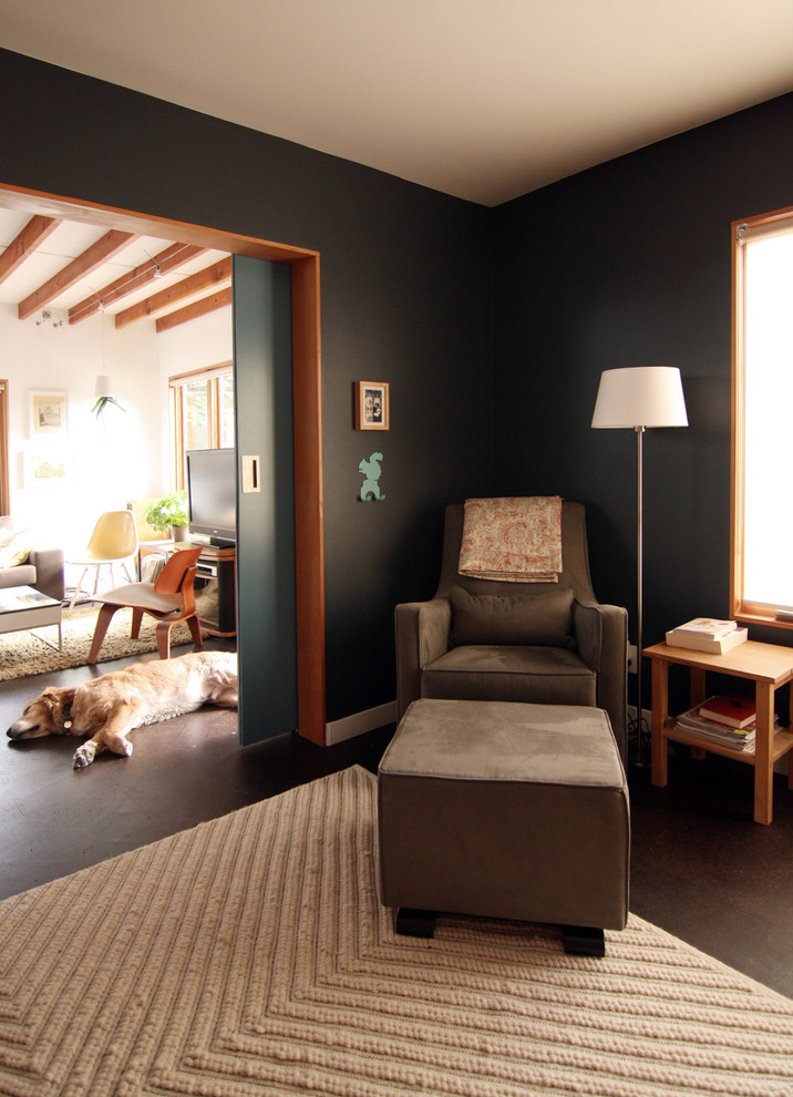 Transitional living room photo in Seattle with black walls
