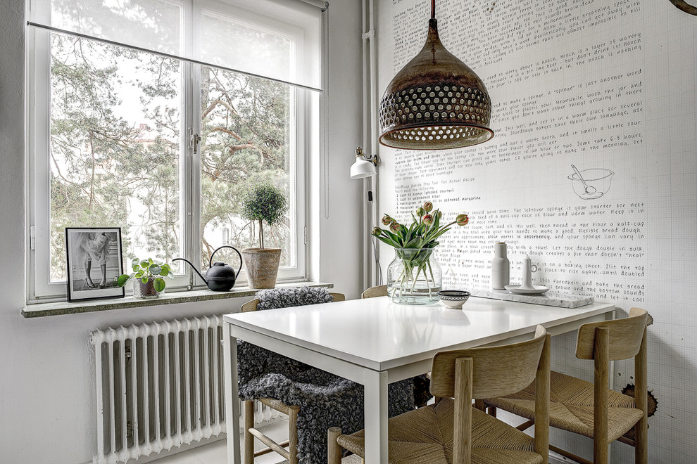 Dining room - scandinavian dining room idea in Stockholm with white walls