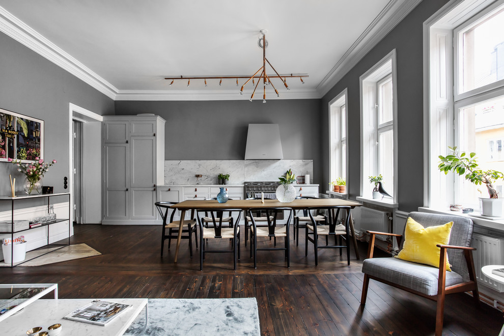 Inspiration for a large scandinavian dark wood floor and brown floor great room remodel in Stockholm with gray walls