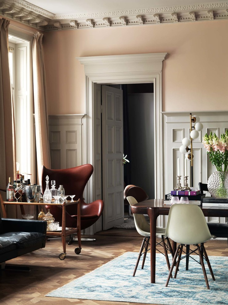 Mid-sized eclectic medium tone wood floor great room photo in Stockholm with pink walls and no fireplace