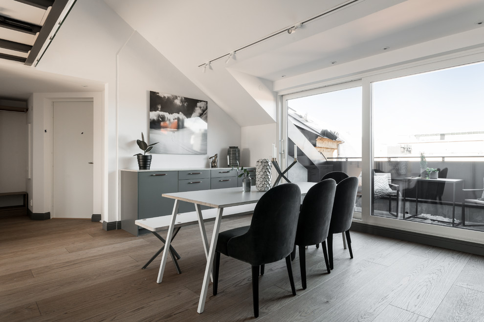 Dining room - scandinavian brown floor dining room idea in Stockholm with white walls