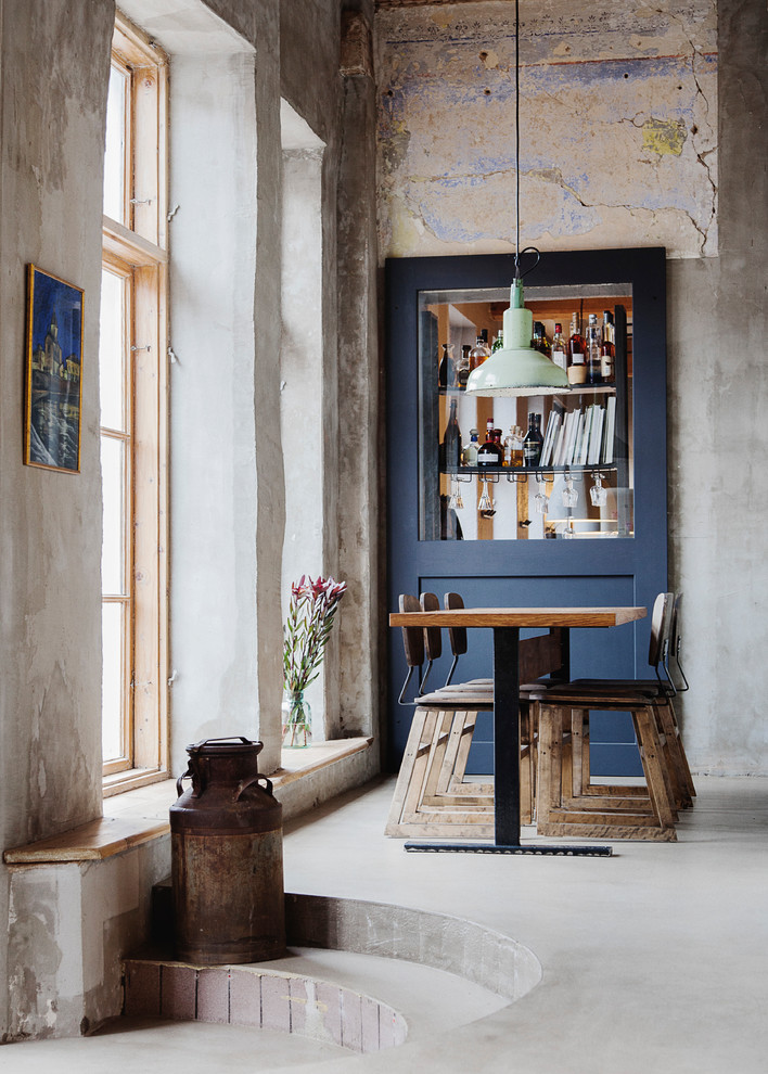 Small urban concrete floor and gray floor dining room photo in Stockholm with gray walls