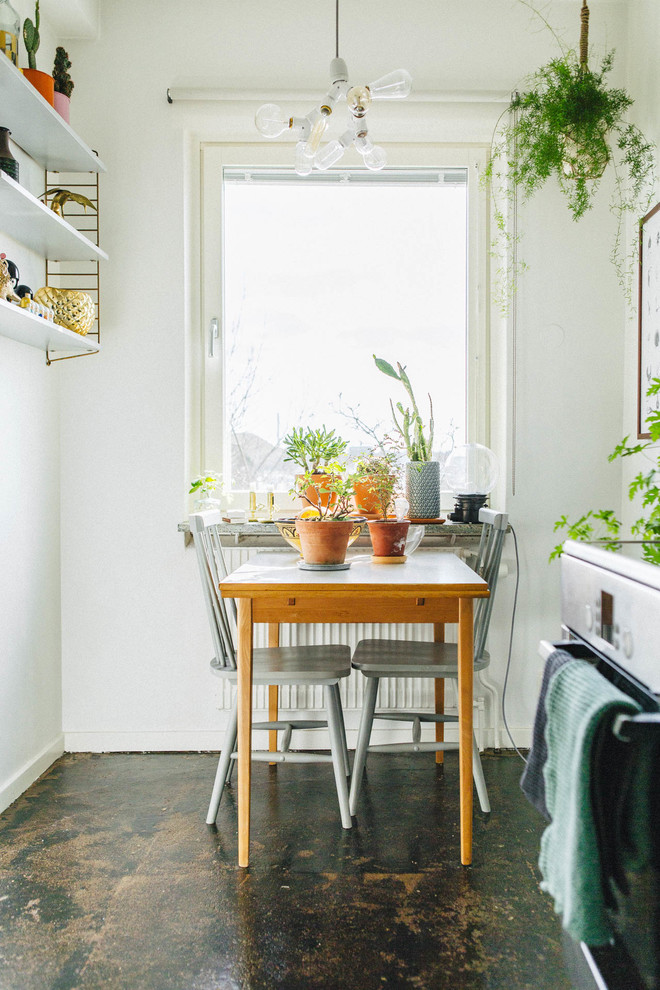 Kitchen/dining room combo - small scandinavian kitchen/dining room combo idea in Stockholm with white walls and no fireplace