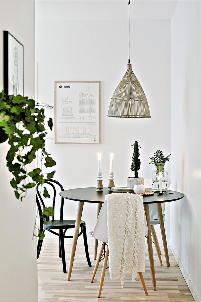 Inspiration for a scandinavian light wood floor dining room remodel in Gothenburg with white walls