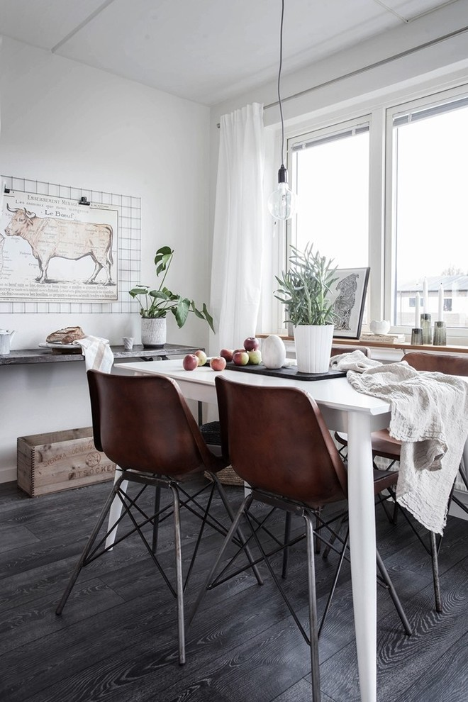 Mid-sized danish dark wood floor dining room photo in Gothenburg with white walls