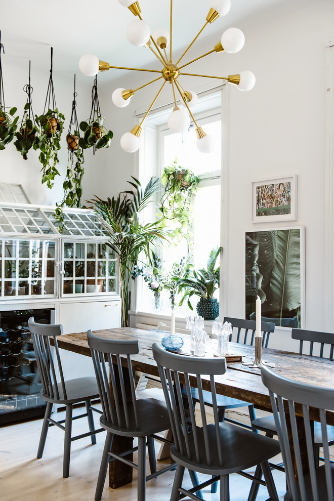 Dining room - eclectic light wood floor and beige floor dining room idea in Stockholm with white walls and no fireplace