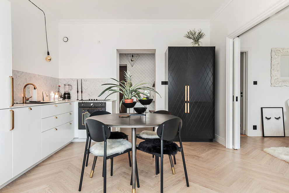 Design ideas for a medium sized scandi open plan dining room in Stockholm with white walls, light hardwood flooring and no fireplace.