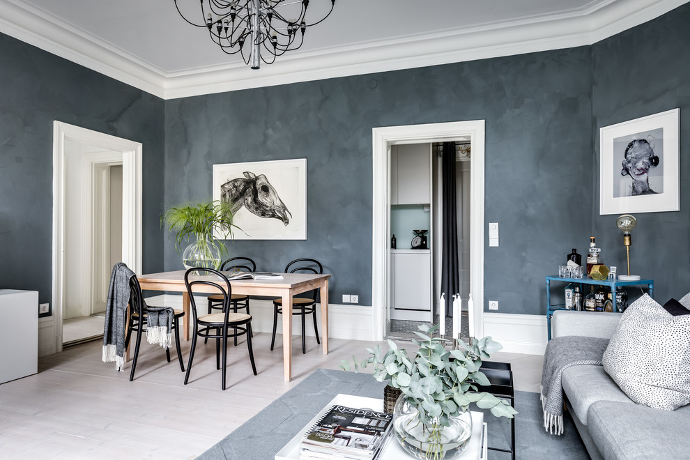 Inspiration for a large scandinavian light wood floor and white floor dining room remodel in Stockholm with gray walls and no fireplace