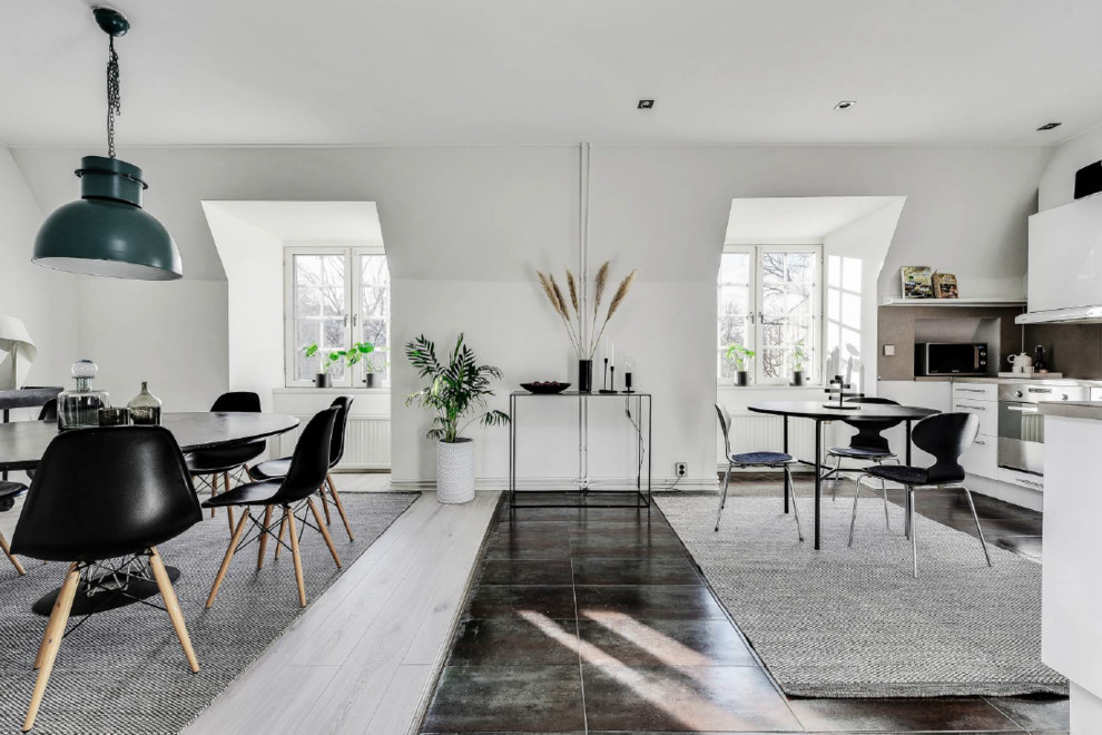 Dining room - scandinavian gray floor dining room idea in Stockholm with white walls