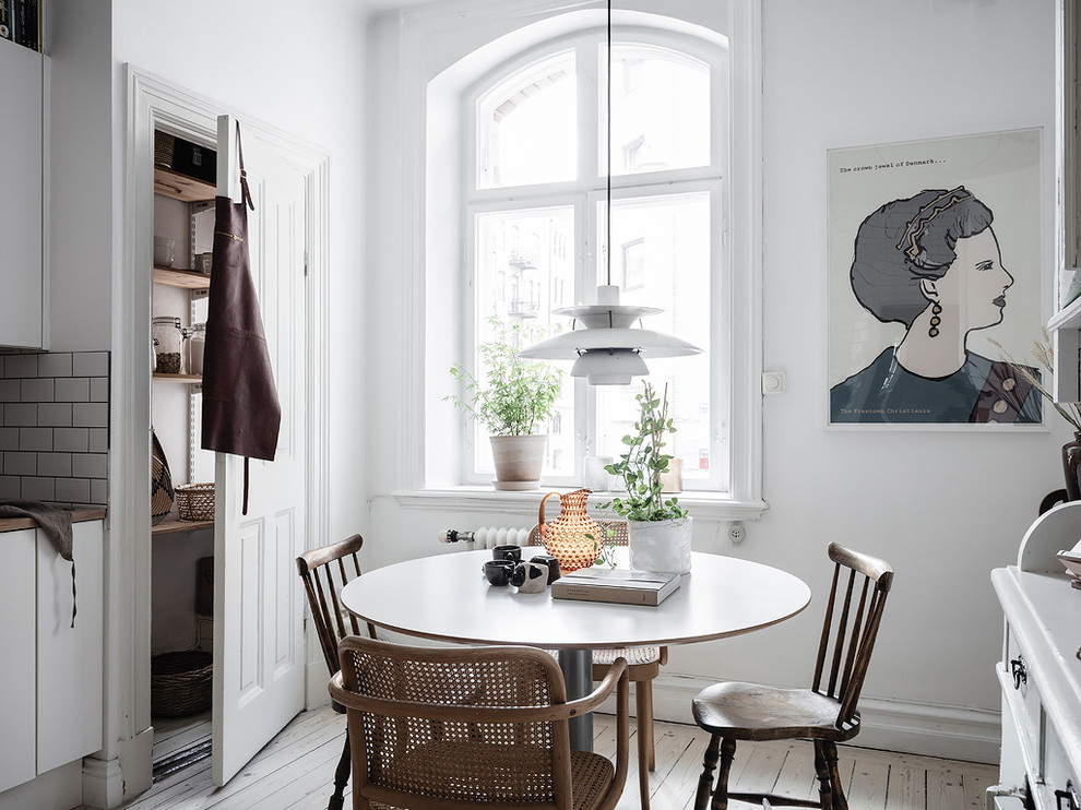 Inspiration for a small scandinavian painted wood floor and white floor kitchen/dining room combo remodel in Gothenburg with white walls and no fireplace