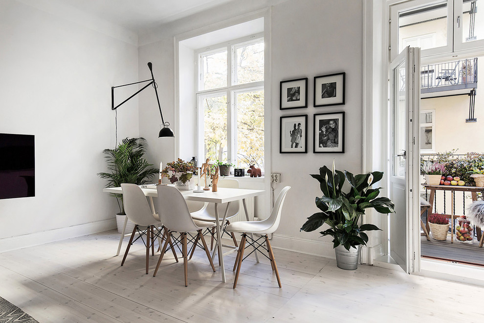 Mid-sized danish painted wood floor great room photo in Stockholm with white walls and no fireplace