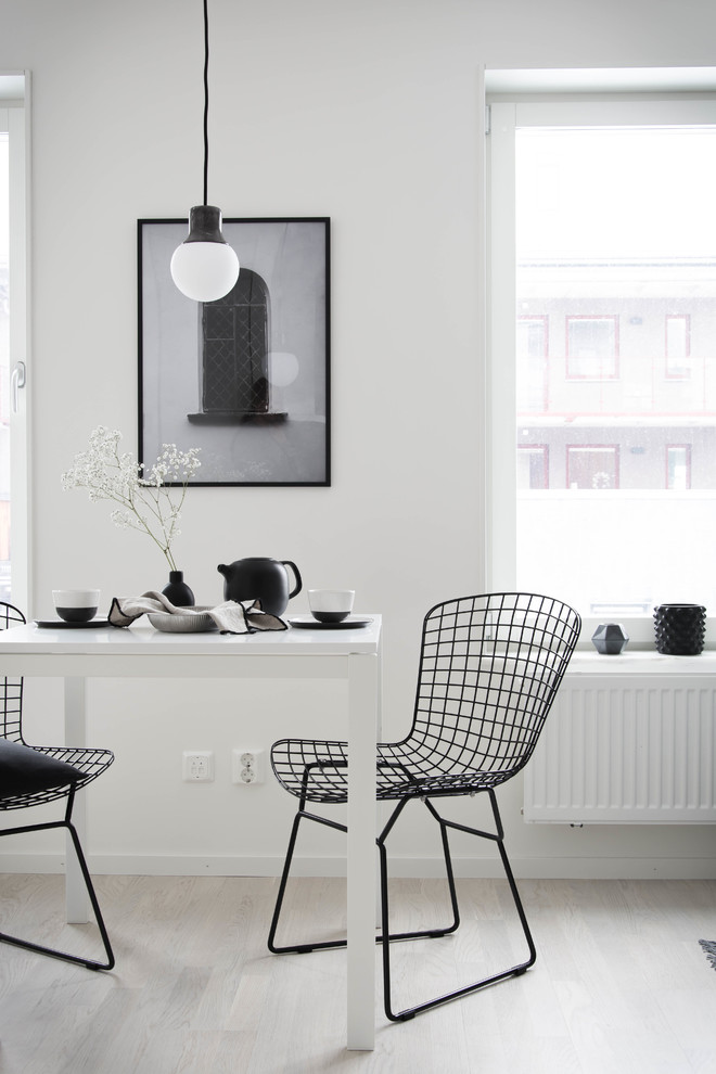Inspiration for a small scandinavian light wood floor dining room remodel in Orebro with white walls and no fireplace