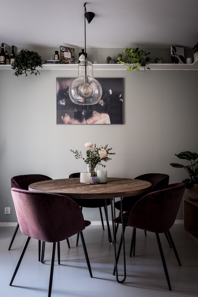 Small danish gray floor enclosed dining room photo in Gothenburg with gray walls