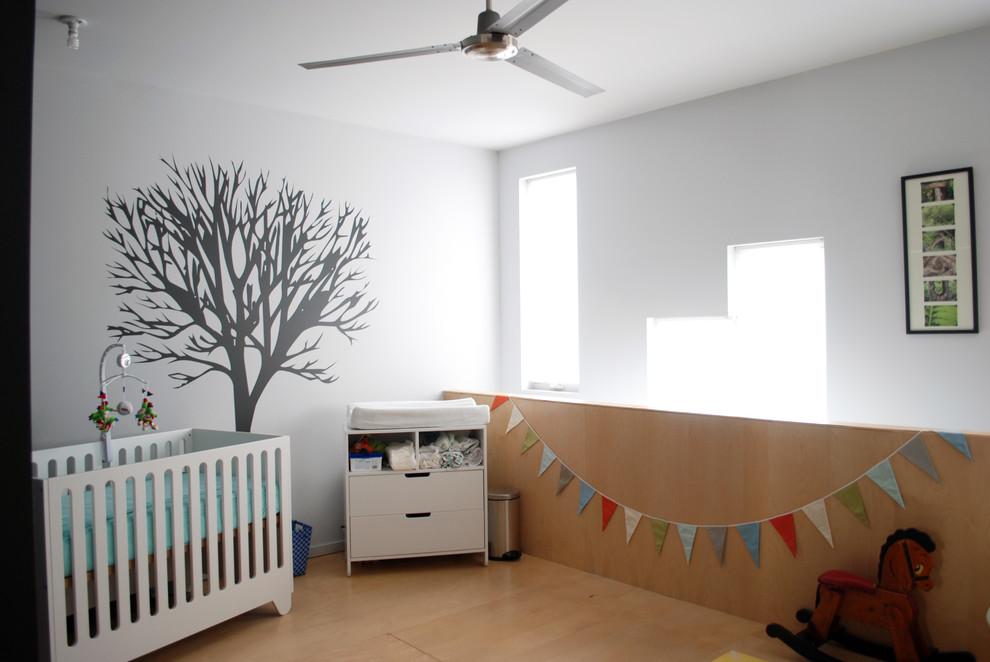 Nursery - modern gender-neutral nursery idea in Philadelphia with white walls