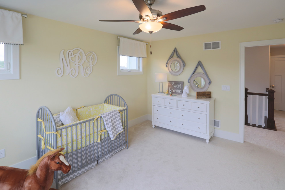 Inspiration for a cottage gender-neutral carpeted nursery remodel in Milwaukee with yellow walls
