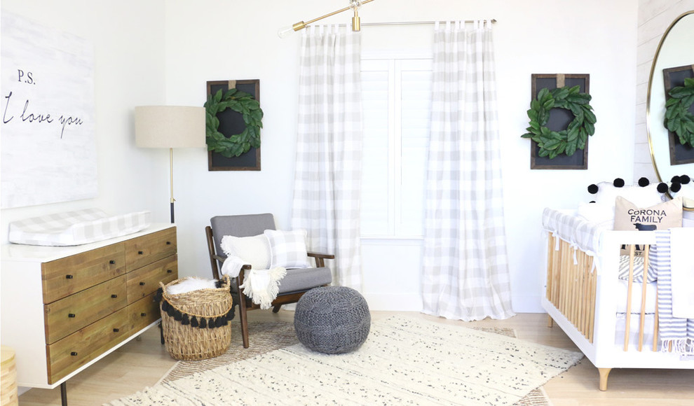 Example of a mid-sized country gender-neutral nursery design in Other with white walls