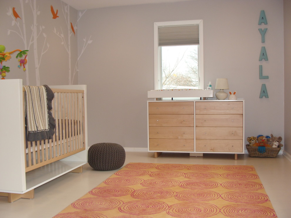 Example of a danish gender-neutral nursery design in New York with gray walls