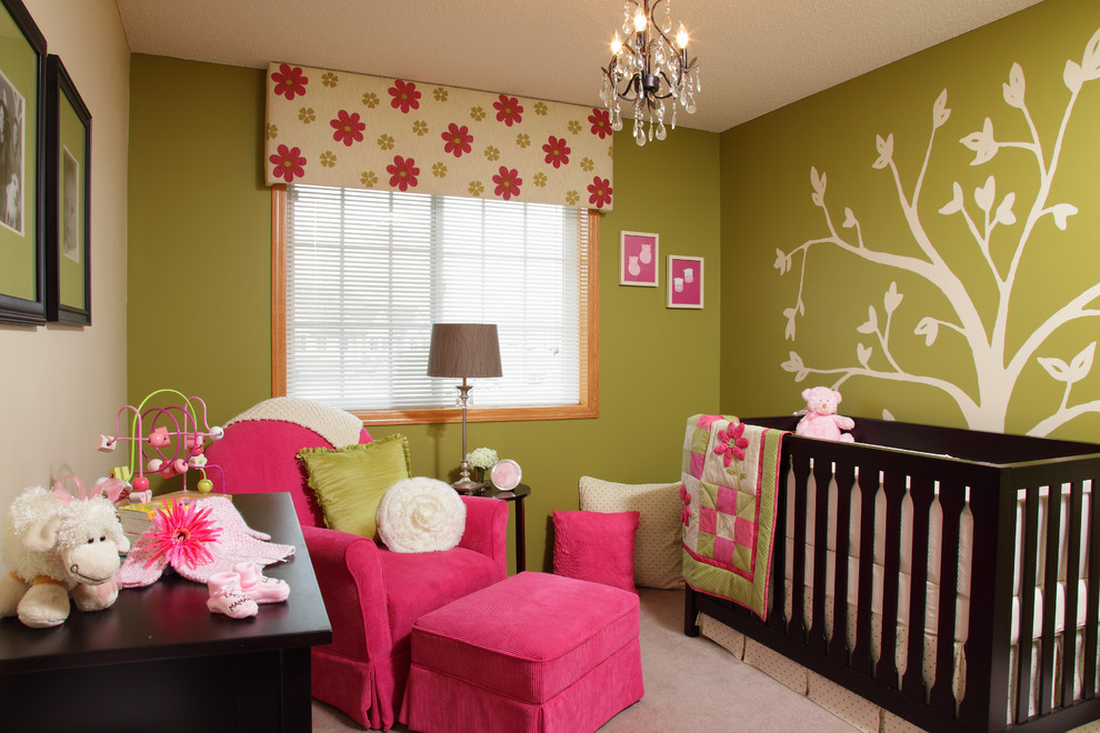 Nursery - contemporary girl carpeted nursery idea in Minneapolis with green walls