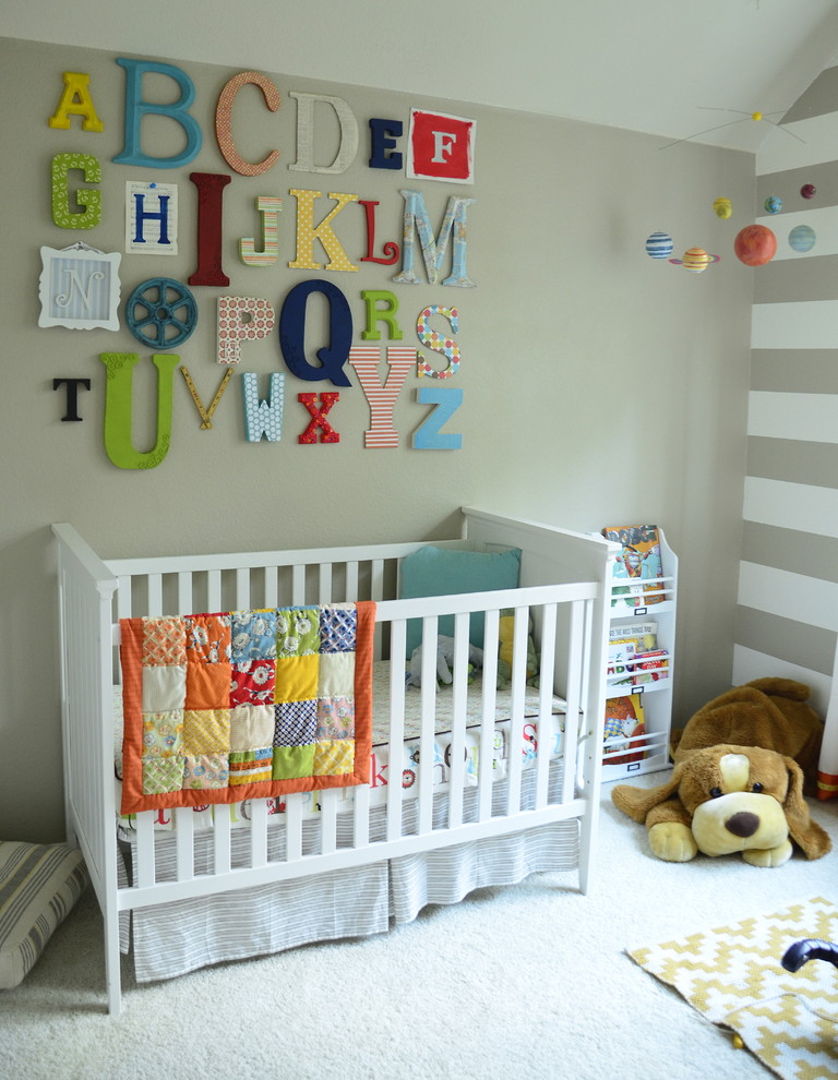 Example of a transitional gender-neutral carpeted nursery design in Austin with beige walls