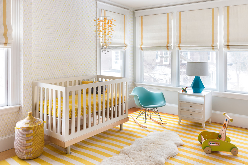 Inspiration for a transitional gender-neutral yellow floor nursery remodel in Boston