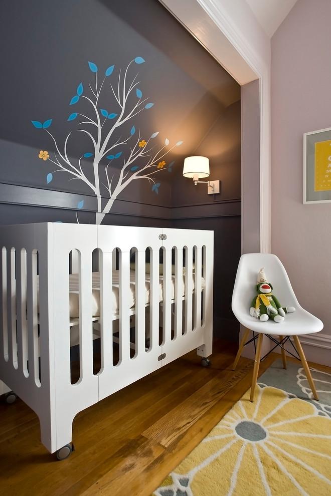 Danish gender-neutral medium tone wood floor nursery photo in San Francisco with gray walls