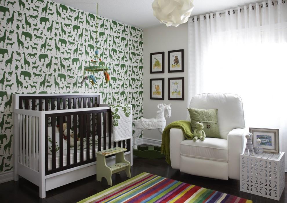 Nursery - contemporary gender-neutral dark wood floor nursery idea in Toronto with multicolored walls