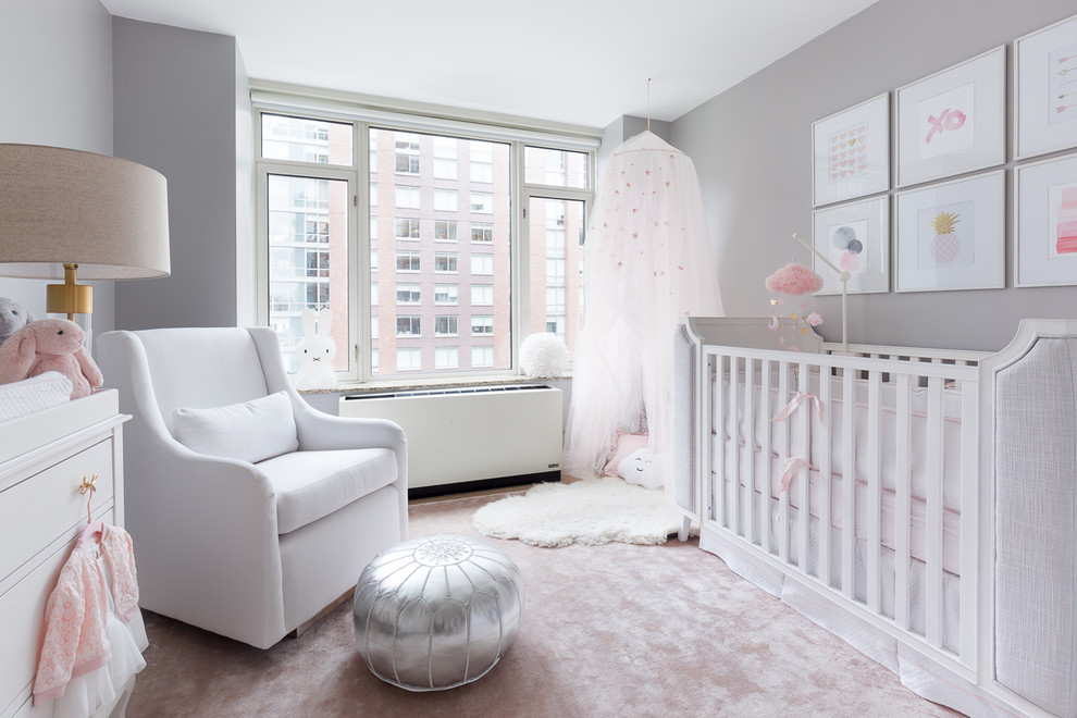 Example of a small transitional girl carpeted and pink floor nursery design in New York with gray walls
