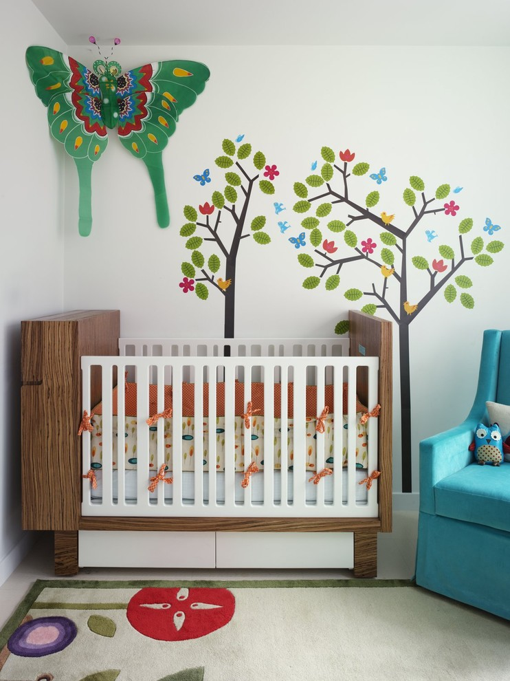 Example of an eclectic nursery design in New York with white walls