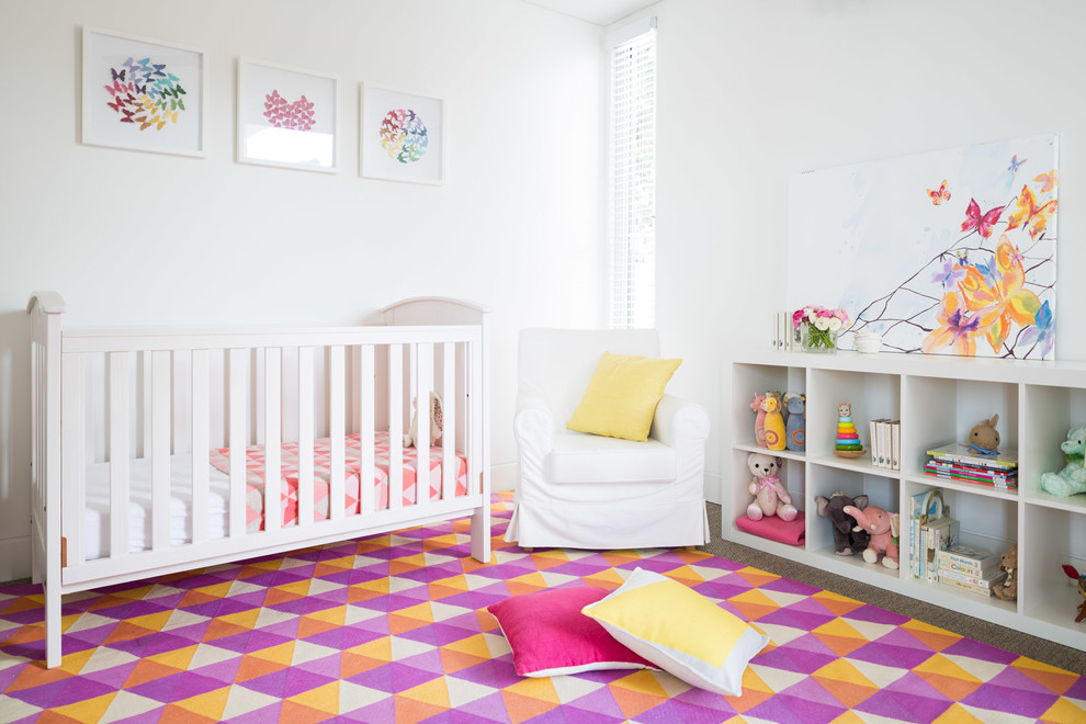 Nursery - mid-sized contemporary girl carpeted and multicolored floor nursery idea in Sydney with white walls