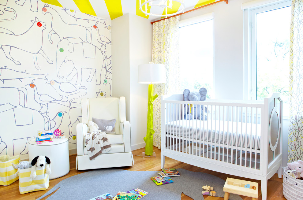 Inspiration for a contemporary gender-neutral medium tone wood floor nursery remodel in New York with white walls