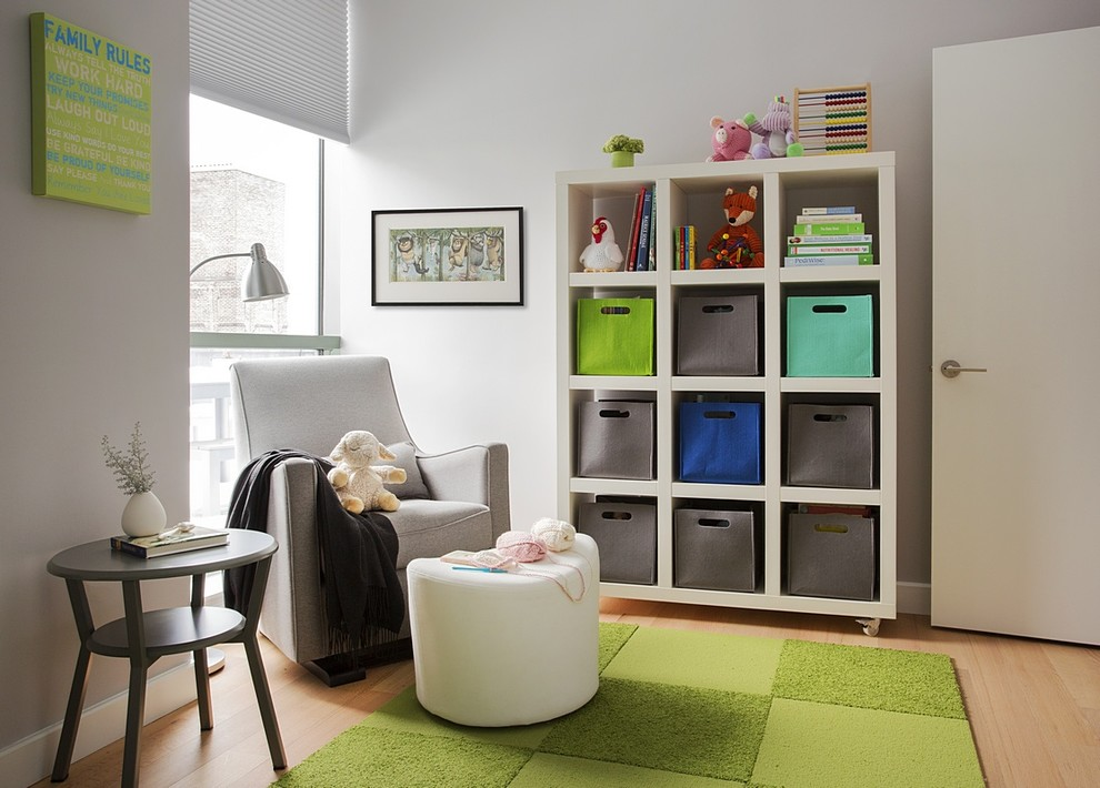 Photo of a mid-sized contemporary gender-neutral nursery in Boston with white walls and light hardwood floors.