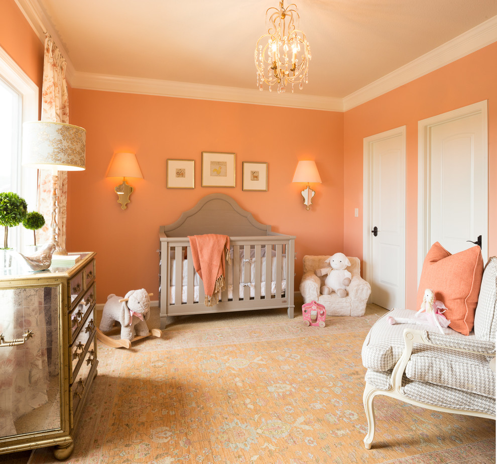 Example of a mid-sized classic girl carpeted and orange floor nursery design in Kansas City with orange walls