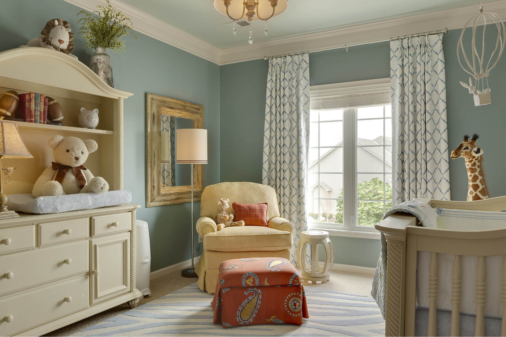 Inspiration for a mid-sized timeless gender-neutral carpeted nursery remodel in Kansas City with blue walls