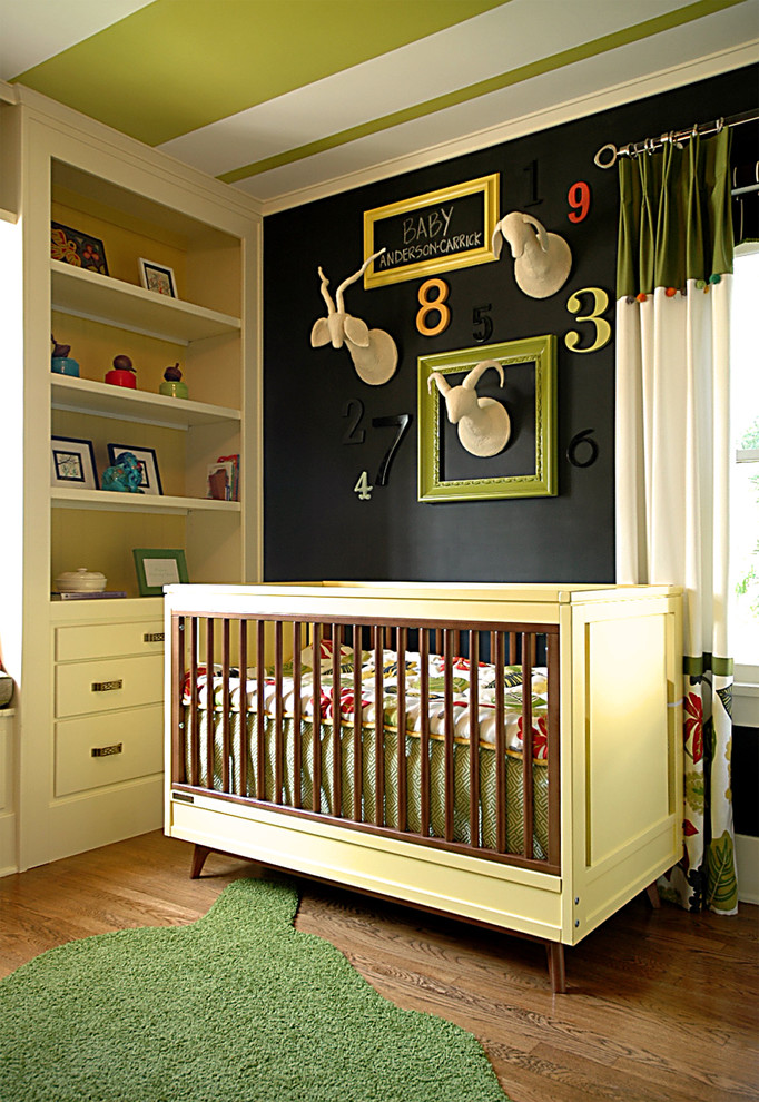 Inspiration for a contemporary gender-neutral dark wood floor nursery remodel in Orange County with black walls