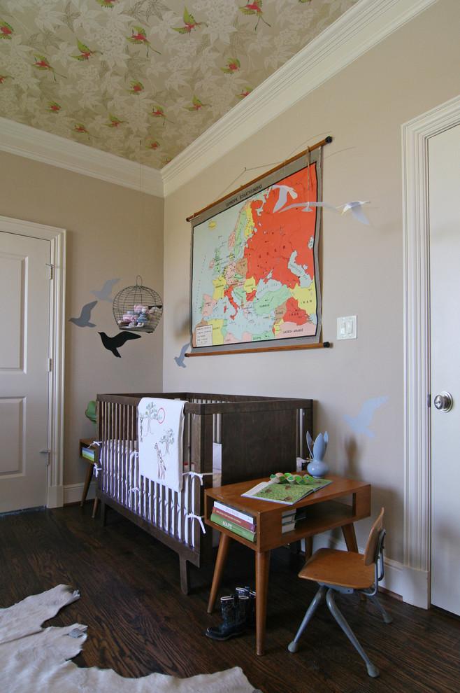 Example of an eclectic gender-neutral dark wood floor nursery design in Dallas with beige walls