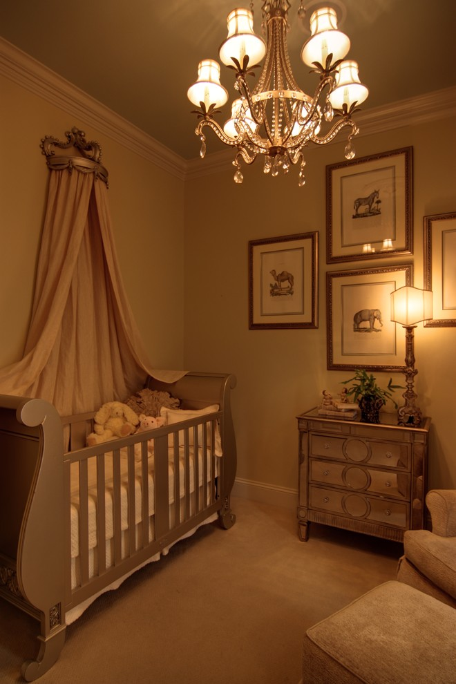 Inspiration for a mid-sized contemporary girl carpeted nursery remodel in New Orleans with beige walls